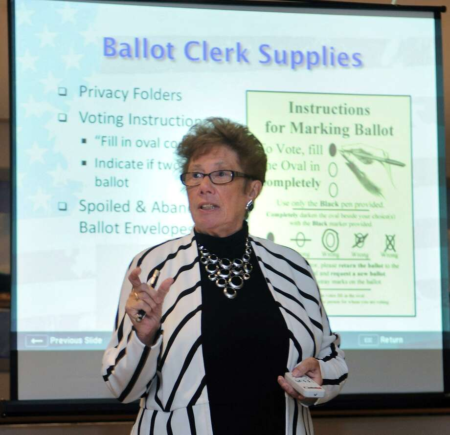 Norwalk Republic Registrar of Voters Karen Doyle Lyons trains poll workers Tuesday, October 23, 2018, in Norwalk, Conn. Photo: Erik Trautmann / Hearst Connecticut Media / Norwalk Hour