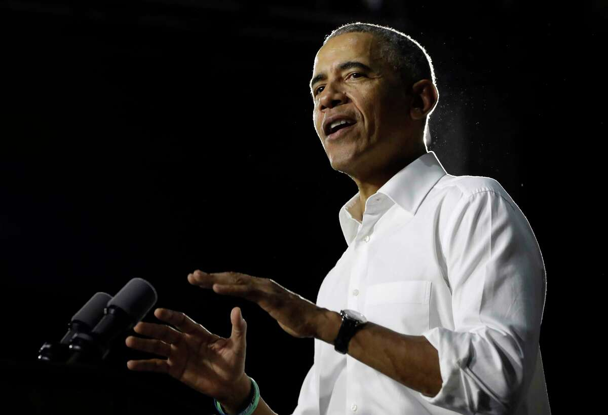 Former President Barack Obama speaks during a campaign rally in support of Democratic candidates, Friday, Nov. 2, 2018, in Miami.