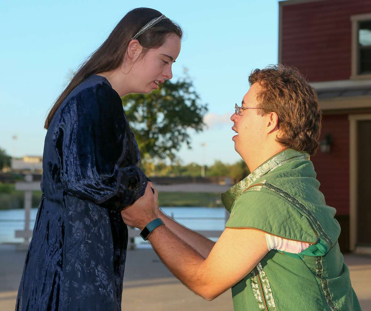 """Brianna Troy, from left, 21, and Gabriel Hey, 24, portray Beatrice and Benedick in a scene from """"Much Ado About Nothing."""" They are a couple off-stage, as well."""