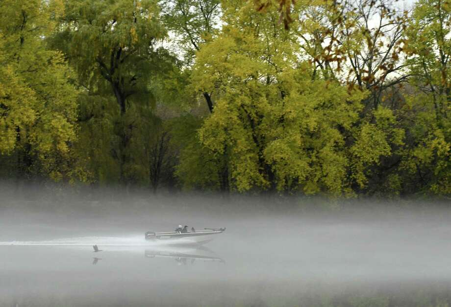 Fog covers the Mohawk River surface as a goose is flushed out of the mist by a passing boater on Friday, Nov. 2, 2018, off Onderdonk Ave. in Colonie, N.Y. (Will Waldron/Times Union) Photo: Will Waldron, Albany Times Union / 40045373A