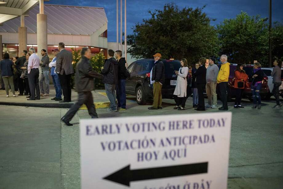 People wait in line to vote at a polling place on the first day of early voting on October 22, 2018 in Houston(Photo by Loren Elliott/Getty Images) Photo: Loren Elliott, Stringer / Getty Images / 2018 Getty Images