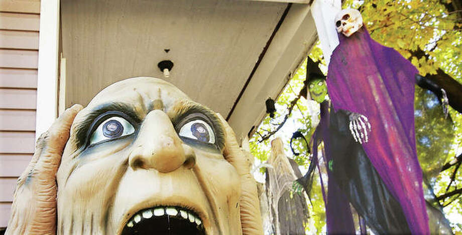 It may have been the trick-or-treaters who do the yelling this year when they visited a house with plenty of decorations in the 1100 block of Main Street in Alton. Photo: John Badman | The Telegraph