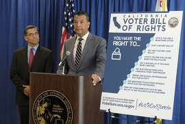 California Secretary of State Alex Padilla, right, and Attorney General Xavier Becerra, left, hold a news conference to discuss voting rights and announce new voter registration numbers Friday, Nov. 2, 2018, in San Francisco. (AP Photo/Eric Risberg)