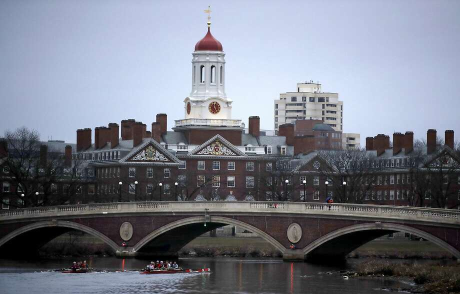 FILE - In this March 7, 2017 file photo, rowers paddle down the Charles River past the campus of Harvard University in Cambridge, Mass.  Photo: Charles Krupa, Associated Press