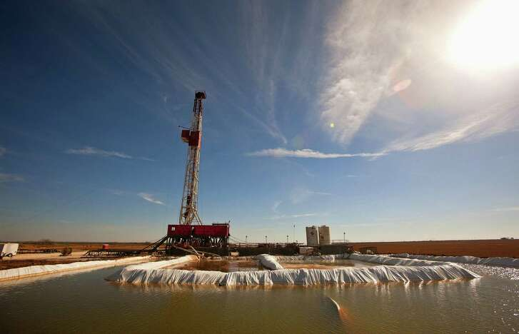 "FILE - This Feb. 17, 2016, file photo shows a water pool attached to Robinson Drilling rig No. 4 in Midland County, Texas. Ken Medlock, director of an energy-studies program at Rice University in Houston, says an assessment Tuesday, Nov. 15, 2016, by the U.S. Geological Survey that the Wolfcamp Shale in the Midland region could yield 20 billion barrels of oil is another sign that ""the revival of the Permian Basin is going to last a couple of decades."" (James Durbin/Reporter-Telegram via AP, File"