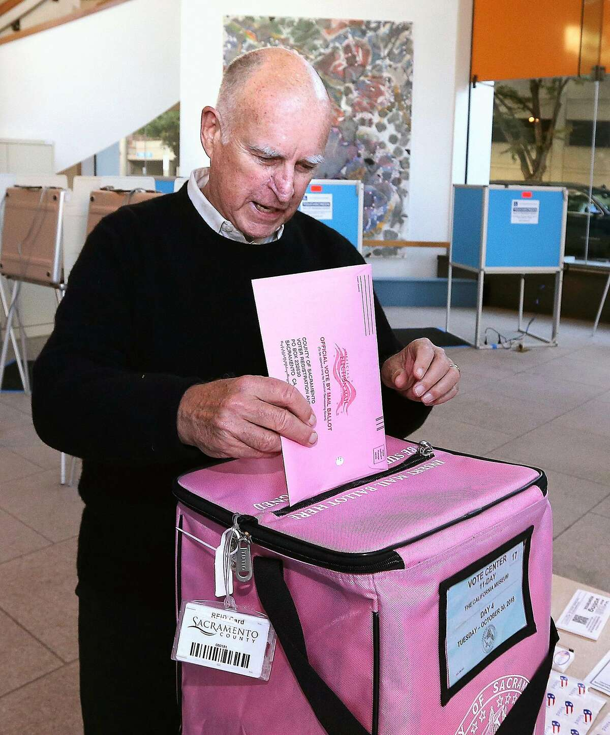 Gov. Jerry Brown casts his ballot at a voting center at The California Museum Tuesday, Oct. 30, 2018, in Sacramento, Calif. One name that wasn't on the ballot this year, was Brown's, who is being termed out of office. Brown will have served 16 years as California's governor, starting in Jan. 1975 through Jan. 3, 1983 and then reelected in November of 2010. (AP Photo/Rich Pedroncelli)