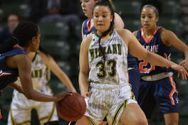 Midland College's Matangiroa Flavell (33) defends against South Plains College on Nov. 29, 2017, at Chaparral Center. James Durbin/Reporter-Telegram