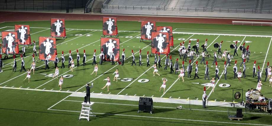 The Stephen F. Austin High School Marching Band & Angels Dance Team advance to the state championship  Advance To State Championship after finishing in fifth place at the UIL Area E 6A contest in Webster. Photo: Nancy Lubrano / Nancy Lubrano