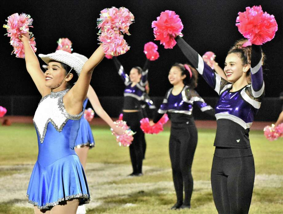 The bands for Needville and Fulshear high schools were not able to perform at halftime during Friday's game at Blue Jay Stadium because they were heading to contest very early Saturday morning. Instead, dance teams from both schools each performed, and then presented a joint routine. In front are Needville Sapphires Dance Team member Cynthia Gaona, left, and Fulshear Storm Dance Team member Yoselin Arellano. Photo: Needville ISD / Needville ISD