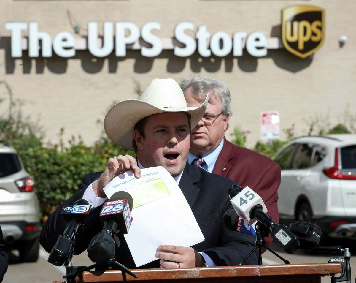 Chris Daniel, Harris County treasurer, speaks about voter registration problems during a press conference in the parking lot of a UPS store, Tuesday, Oct. 30, 2018, in Houston. State Sen. Bettencourt said 84 people are registered to vote at the UPS store through post office boxes.