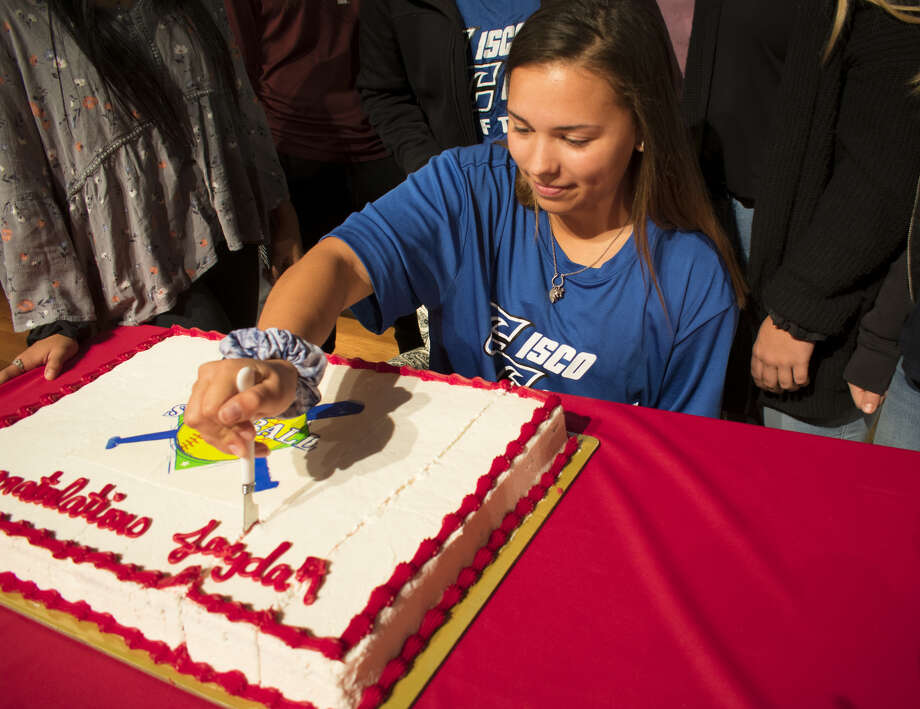 Coahoma softball player Jaydan Mann cuts her cake after announcing her commitment to Cisco College. Photo: Lyndel Moody | Coahoma ISD
