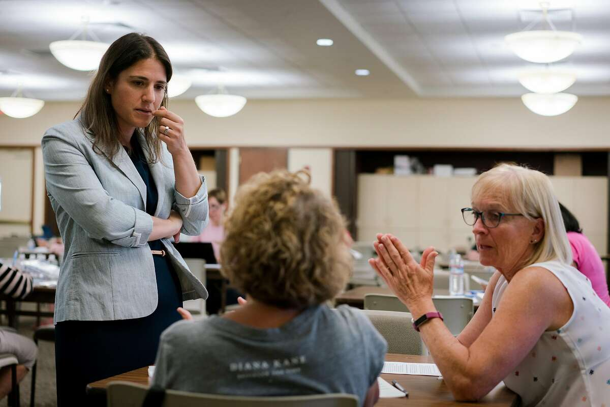 (Left) Rebecca Bauer-Kahan speaks with women at a phone bank in Walnut Creek, Calif., on Wednesday, September 26, 2018. Bauer-Kahan has taken a slight lead in returns posted Friday.