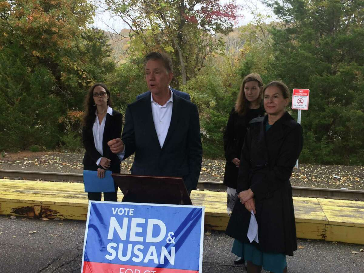 Ned Lamont, the Democratic gubernatorial candidate, promises $14 million in state bonding for a Valley Firefighter Training Center in Beacon Falls during a stop at the Derby train station Nov. 2, 2018. To his right is Susan Bysiewicz, his running mate. Behind him are Kara Rochelle, a candidate for the vacant 104th State House seat and Mary Welander, a candidate for the 114th State House seat