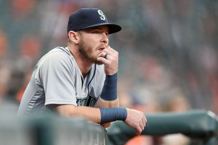 BALTIMORE, MD - JUNE 26: Chris Herrmann #26 of the Seattle Mariners looks on from the dug out during a baseball game against the Baltimore Orioles at Oriole Park at Camden Yards on June 26, 2018 in Baltimore, Maryland. The Mariners won 3-2. (Photo by Mitchell Layton/Getty Images)