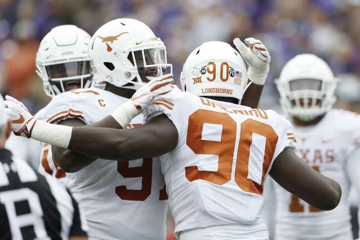UT defensive linemen Jamari Chisholm, left, and Charles Omenihu will try to contain West Virginia QB Will Grier, a Heisman Trophy candidate.