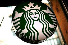 This March 24, 2018, file photo shows a sign in a Starbucks located in downtown Pittsburgh. Starbucks is restructuring its European operations after several years of slowing sales. The Seattle-based coffee chain is selling 83 company-owned stores in France, the Netherlands, Belgium and Luxembourg to its longtime partner, Alsea. (AP Photo/Gene J. Puskar, File)