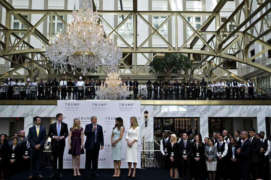 Then-GOP presidential nominee Donald Trump speaks at the grand opening ceremony of the Trump International Hotel in Washington, D.C., on Oct. 26, 2016. With are sons Donald Trump Jr., from left, and Eric Trump, daughter Tiffany Trump, wife Melania Trump and daughter Ivanka Trump. Photo: Andrew Harrer/Bloomberg / Bloomberg