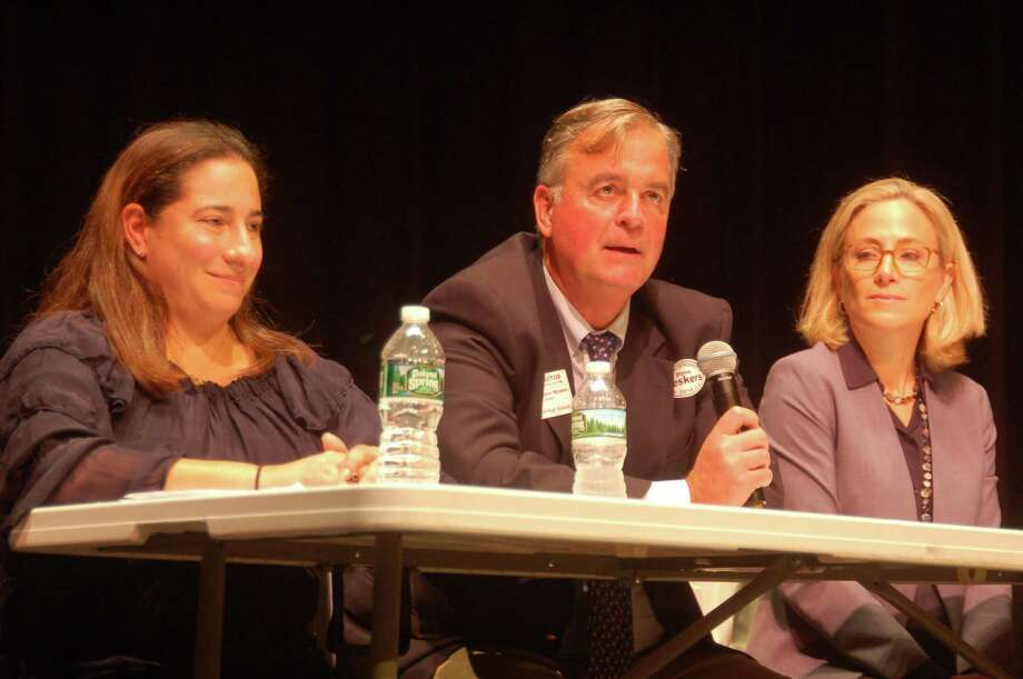 From left, Democratic state legislature candidates Laura Kostin in the 151st House District, Stephen Meskers in the 150th House District, and Alexandra Bergstein in the 36th Senate District, all take part in a Friday debate at Greenwich High School before a crowd of more than 500 students. Photo: Ken Borsuk / Hearst Connecticut Media /
