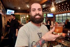 New Haven, Connecticut - Friday, November 2, 2018: Conrad Meurice, the beverage director for the Bears Restaurant Group,shows off a Maple Bacon Old Fashioned craft cocktail at Stack Friday evening, the new barbecue restaurant and microbrewery at The District on James Street in New Haven.