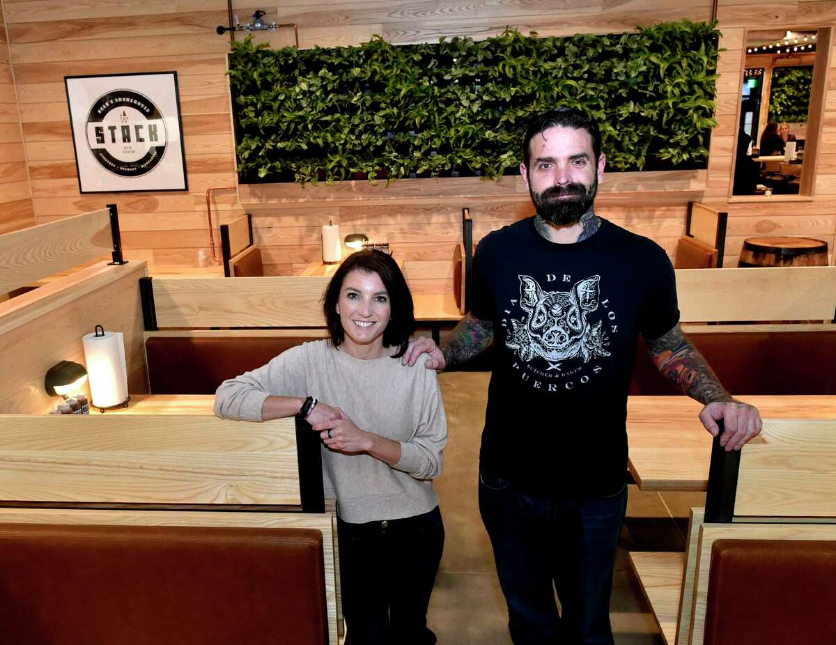 New Haven, Connecticut - Friday, November 2, 2018: Cheryl McDonald, left, and her husband Jamie McDonald, right, owners of Stack and the Bears Restaurant Group during a press event Friday evening at their new barbecue restaurant and microbrewery, Stack, at The District on James Street in New Haven.