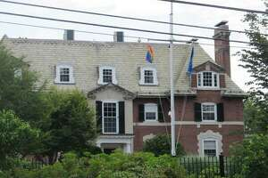 The gay pride flag flies outside the Governor's Residence in Hartford in 2013, after the U.S. Supreme Court struck down a key part of the Defense of Marriage Act.