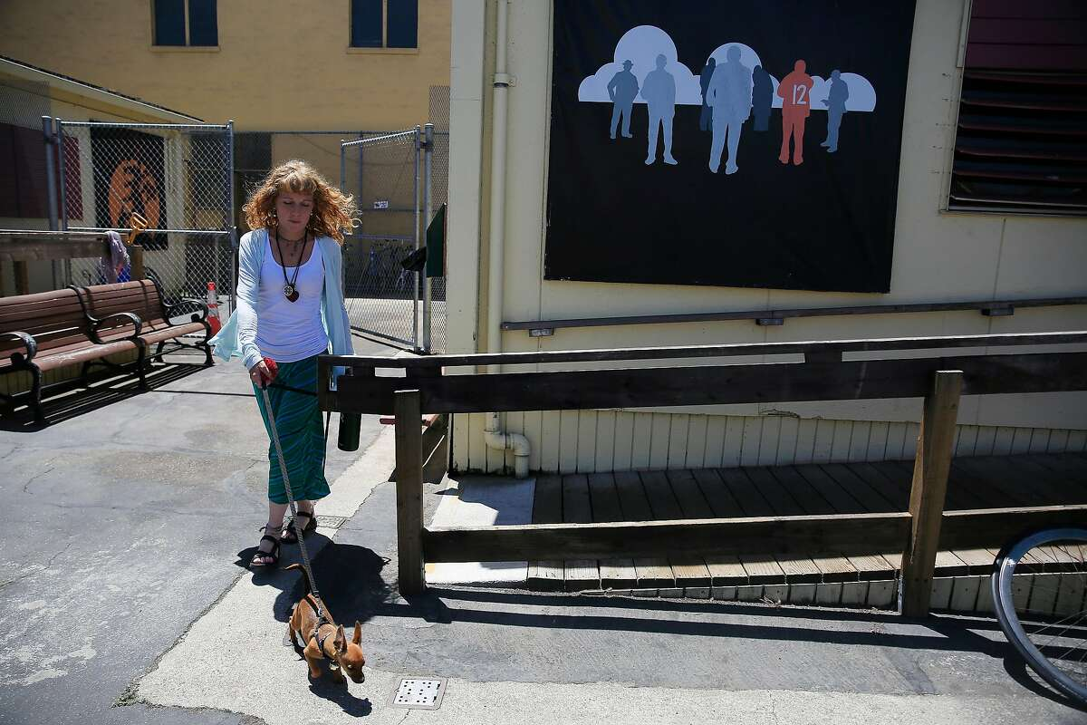 Sabrina Jones walks her dog, Lucy, at the Mission Navigation Center on Friday, June 22, 2018 in San Francisco, Calif. Jones was homeless for 10 years.