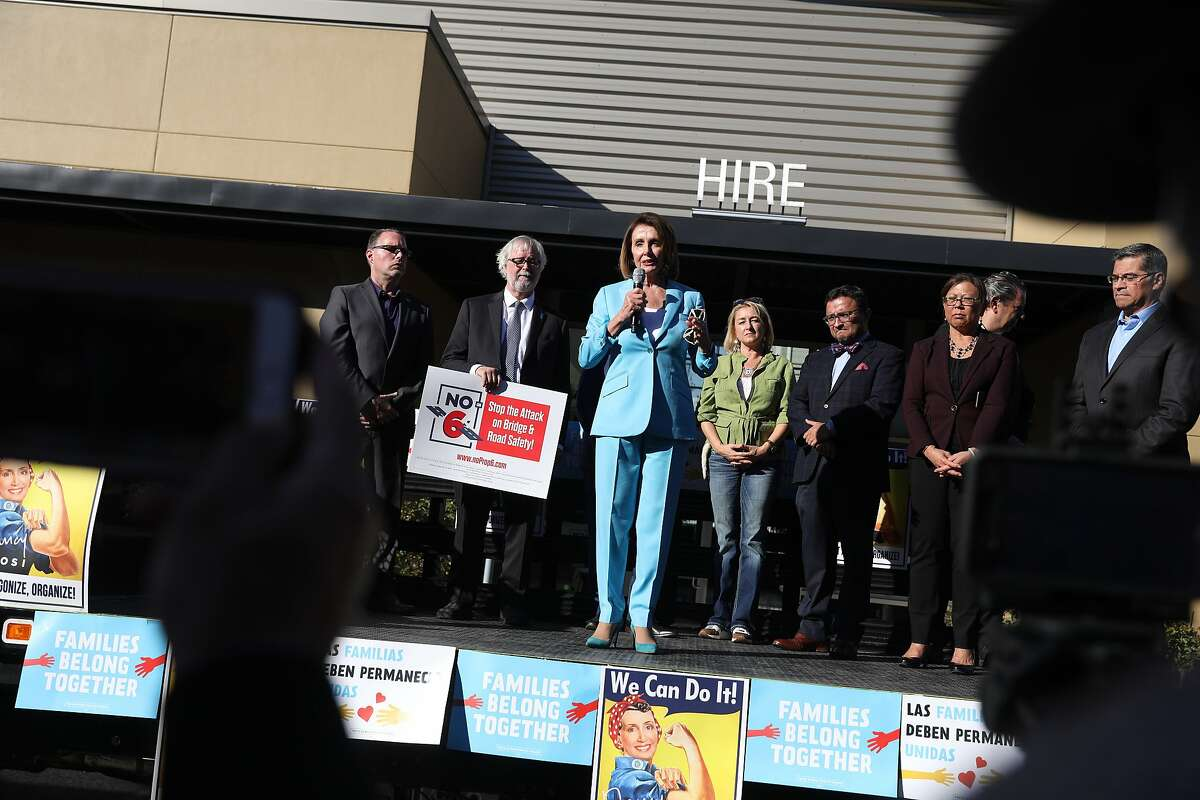 Nancy Pelosi walks up steps to the back of a truck to speak at a press conference at Laborers' Local 261 On Friday, November 2, 2018 in San Francisco, Calif.