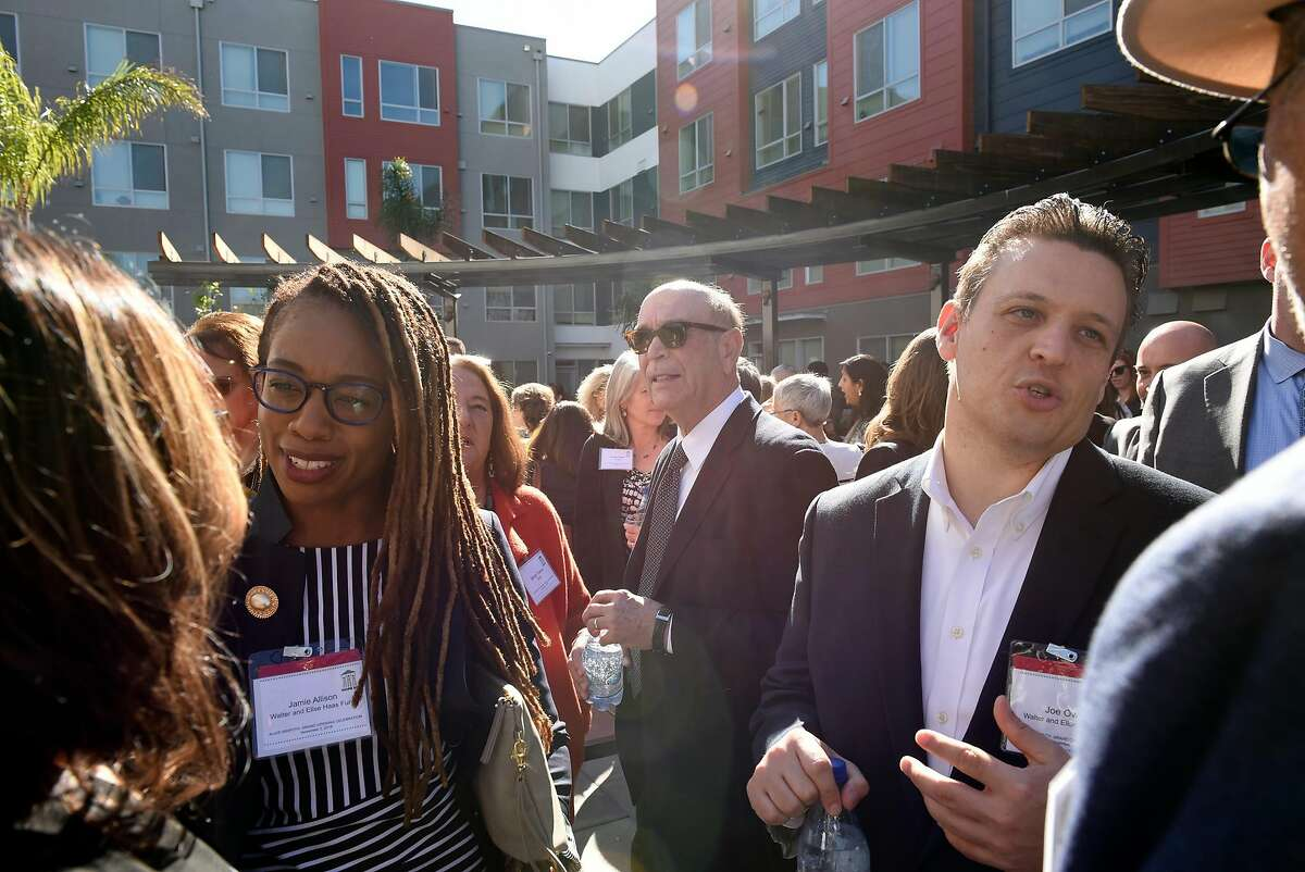 Guests mingle at the Alice Griffith housing development before a ribbon cutting ceremony, in San Francisco, CA, on Friday November 2, 2018.
