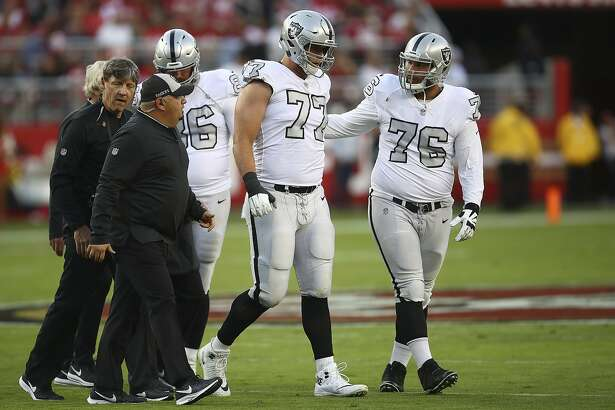Oakland Raiders offensive tackle Kolton Miller (77) walks off the field after being tended to by trainers during the first half of an NFL football game against the San Francisco 49ers in Santa Clara, Calif., Thursday, Nov. 1, 2018. (AP Photo/Ben Margot)