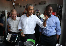 MIAMI, FLORIDA - NOVEMBER 02: Former U.S. President Barack Obama orders lunch with Florida Democratic gubernatorial candidate Andrew Gillum (R) and U.S. Senator Bill Nelson (D-FL) (L) at the Coyo Taco restaurant on November 02, 2018 in Miami, Florida. Former President Obama visited the area to campaign for Nelson and Gillum who are in tight races against their Republican opponents. (