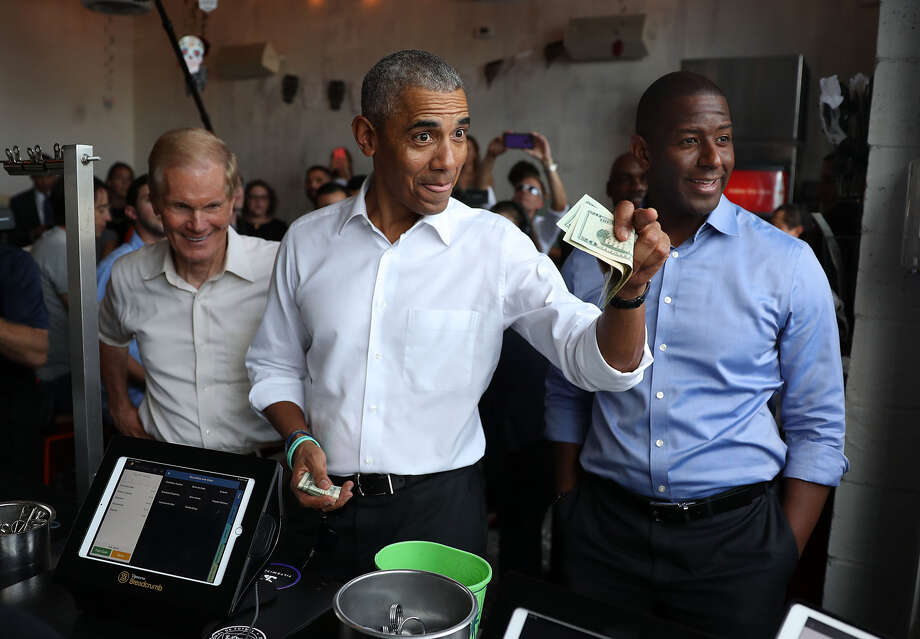 MIAMI, FLORIDA - NOVEMBER 02: Former U.S. President Barack Obama orders lunch with Florida Democratic gubernatorial candidate Andrew Gillum (R) and U.S. Senator Bill Nelson (D-FL) (L) at the Coyo Taco restaurant on November 02, 2018 in Miami, Florida. Former President Obama visited the area to campaign for Nelson and Gillum who are in tight races against their Republican opponents. ( Photo: Photo By Joe Raedle/Getty Images)
