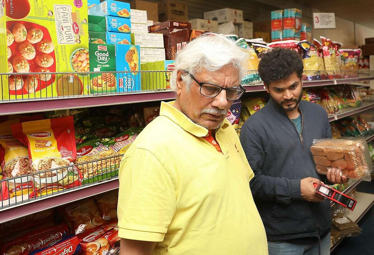 Owner Rakesh Marwaha restocking shelves at Jai Ho Indian grocery store on Thursday, Nov. 1, 2018, in San Francisco, Calif.