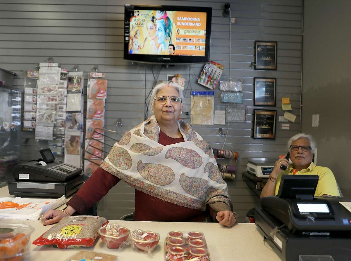 Owner Rakesh Marwaha (right) and his wife, Rama Marwaha (middle front) at Jai Ho Indian grocery store on Thursday, Nov. 1, 2018, in San Francisco, Calif.