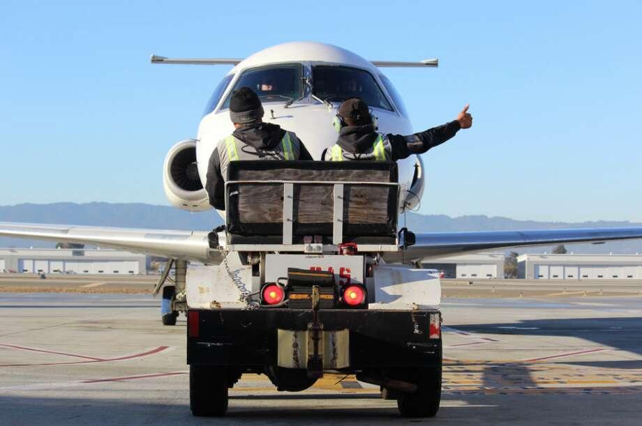 The first California Pacific E145 flight at Mineta San Jose gets a tug Photo: SJC
