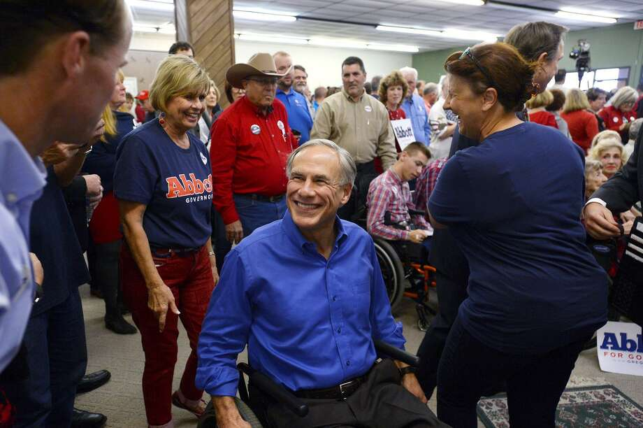 Gov. Greg Abbott greets State Rep. Dade Phelan during a campaign stop at the Jefferson County Republican Party's office in Port Neches on Wednesday. Photo taken Wednesday 10/24/18 Ryan Pelham/The Enterprise Photo: Ryan Pelham / The Enterprise / ©2018 The Beaumont Enterprise