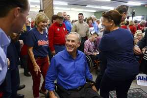 Gov. Greg Abbott greets State Rep. Dade Phelan during a campaign stop at the Jefferson County Republican Party's office in Port Neches on Wednesday. Photo taken Wednesday 10/24/18 Ryan Pelham/The Enterprise