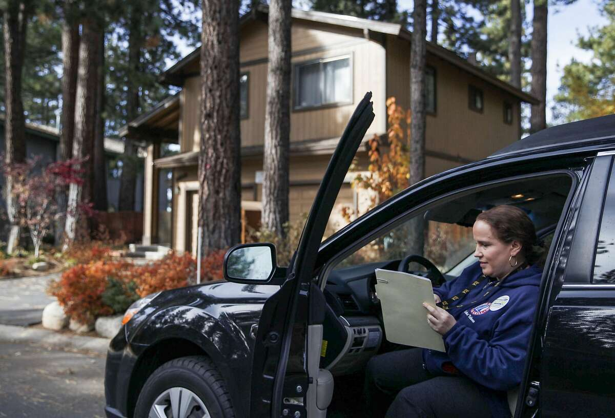 No on T campaign volunteer Sharon Kerrigan exits her vehicle while canvassing homes in South Lake Tahoe, Calif. Friday, Nov. 2, 2018.