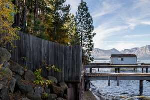 Private docks owned by waterfront rental properties are seen along the shore of Lake Tahoe in South Lake Tahoe, Calif. Friday, Nov. 2, 2018.