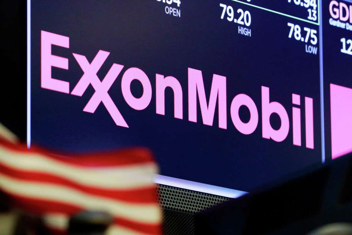 The logo for ExxonMobil appears above a trading post on the floor of the New York Stock Exchange on April 23, 2018.