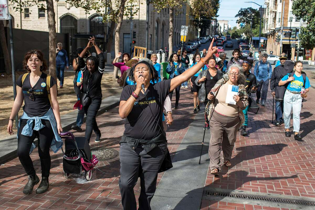 Melanie DeMore, Vocal Activist, sings and leads a procession in the Tenderloin as they march to City Hall to cast their votes or encourage others to do so on Saturday, October 27, 2018 in San Francisco, Calif.