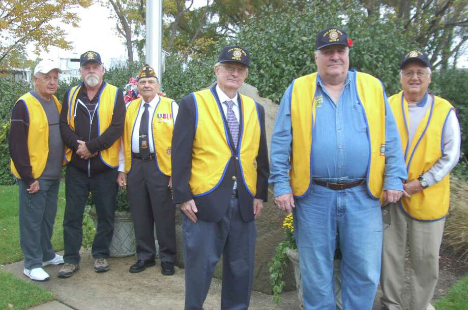 The Cos Cob Veterans of Foreign Wars Post 10112, who recently marked their 50th anniversary, will hold a Veterans Day ceremony at their memorial in the Strickland Road Park, on Nov. 10. Pictured from left: post members Doc Orrico, quartermaster, Regis Gmitter, Anthony Marzullo, service officer, Bill Cameron, post adjutant, Post Commander Joe Musich and Peter Orrico. Photo: – Ken Borsuk / Hearst Connecticut Media /