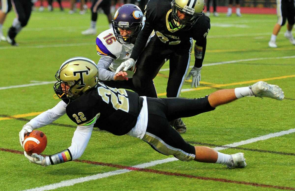 Trumbull's Daniel Arganese completes a pass during football action against Westhill in Trumbull, Conn., on Friday Nov.2, 2018.