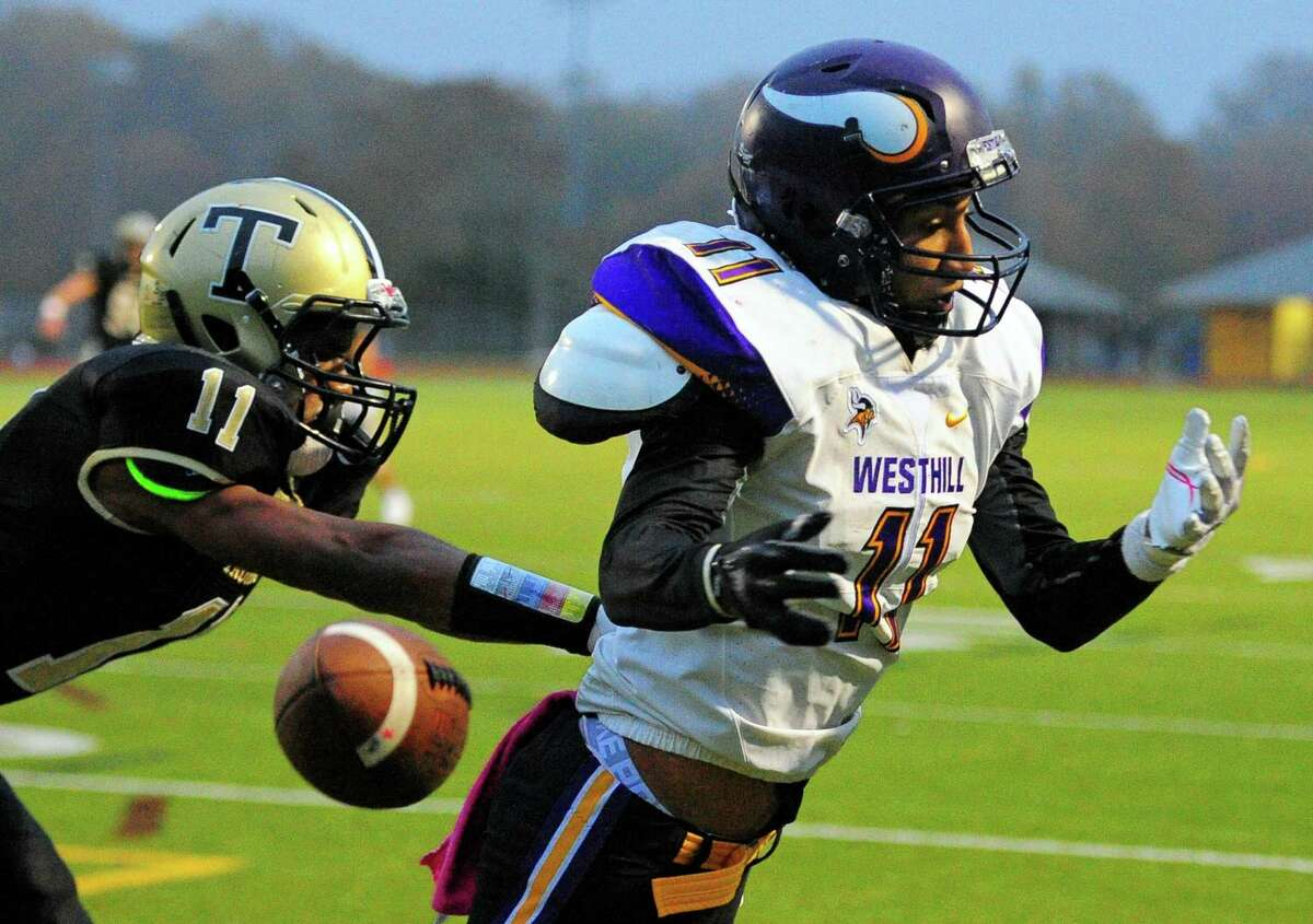 Westhill's John Mendez misses a touchdown pass during football action against Trumbull in Trumbull, Conn., on Friday Nov.2, 2018. At left is Trumbull's Aidan Clark.