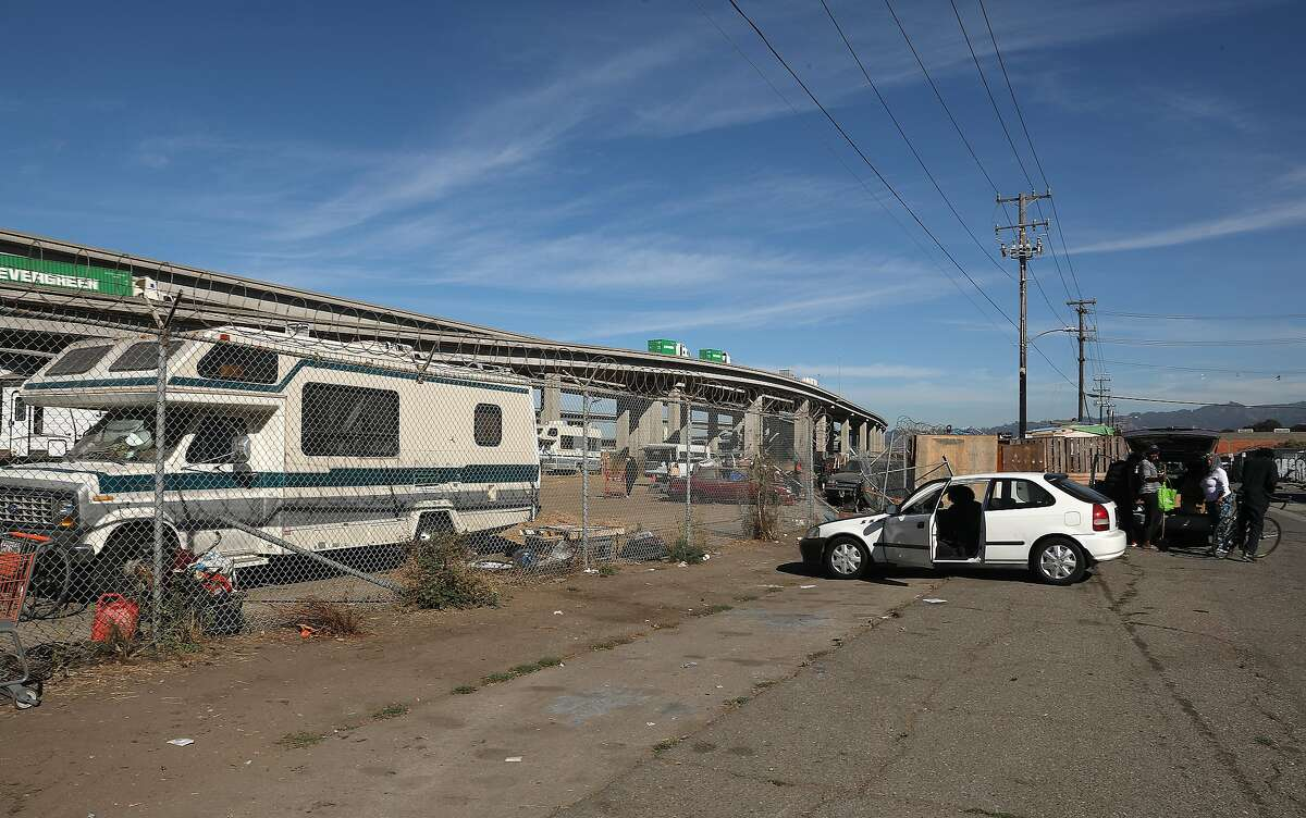 Several RV's are seen here on a field off of Wood Street on Friday, Nov. 2, 2018, in Oakland, Calif. The Oakland City Council voted to open four RV sites in the city that will provide up to 150 RVs with secure parking, sanitary facilities and garbage services.
