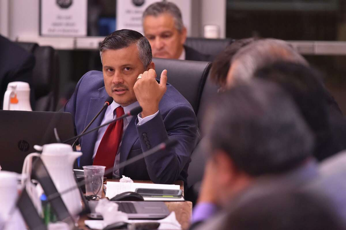 Harlandale ISD board member David Abundis makes a point during a 2018 board meeting. He abruptly resigned last week.