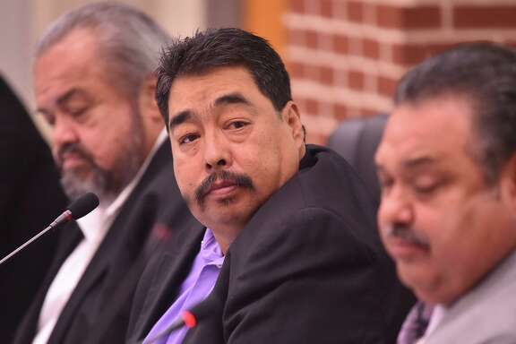 Harlandale ISD President Juan Mancha listens to a presentation during a recent board meeting.