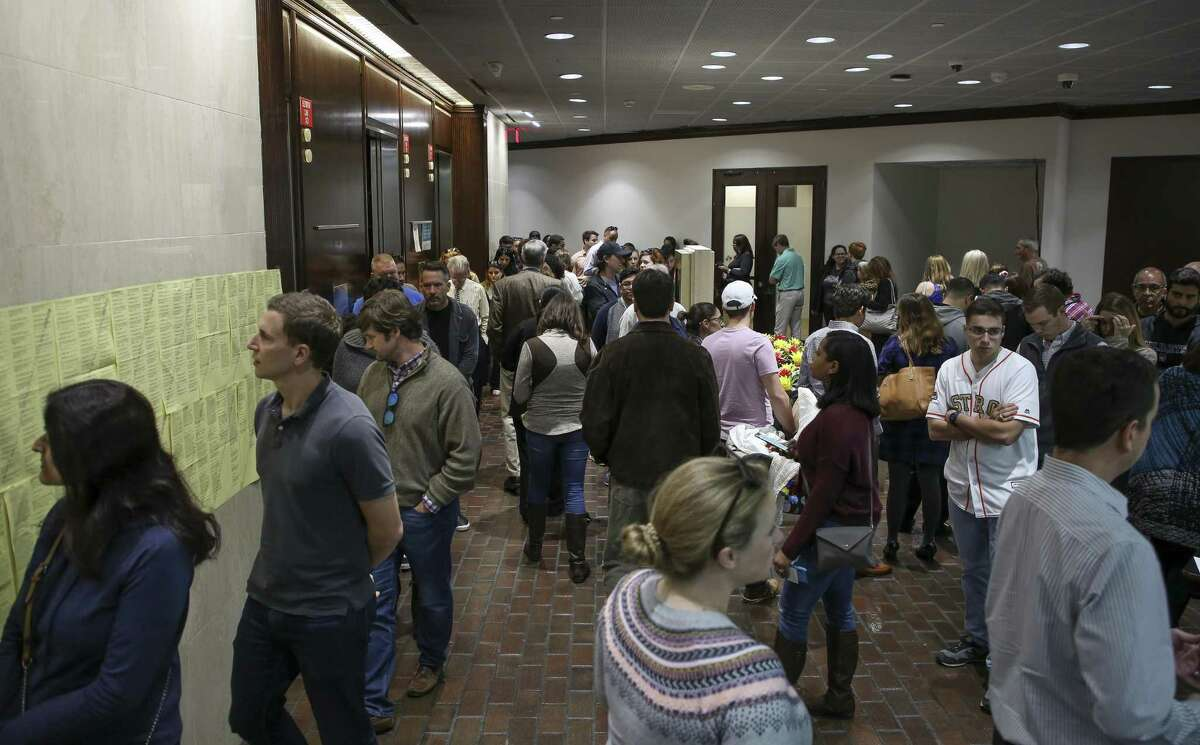 Harris County residents wait in line at the early voting polling station at the Harris County Public Health building Friday, Nov. 2, 2018, in Houston. >> PHOTOS: Most unusual polling stations in Houston...