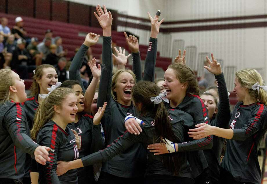 Oak Ridge players react after sweeping Vandegrift in straight sets during a Region II-6A area high school playoff match at A&M Consolidated High School, Friday, Nov. 2, 2018, in College Station. Photo: Jason Fochtman, Houston Chronicle / Staff Photographer / © 2018 Houston Chronicle