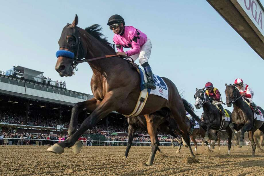West Coast ridden by jockey Mike Smith lead wire to wire on the way to the win in the 148th running of The Travers Stakes at the Saratoga Race Course in Saratoga Springs, N.Y.  (Skip Dickstein/Times Union) Photo: SKIP DICKSTEIN