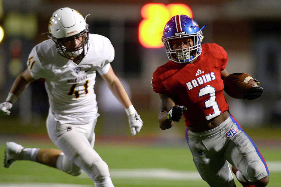West Brook running back Robert McGrue evades a tackle en route to a touchdown against Deer Park at Beaumont ISD Memorial Stadium on Friday night. 